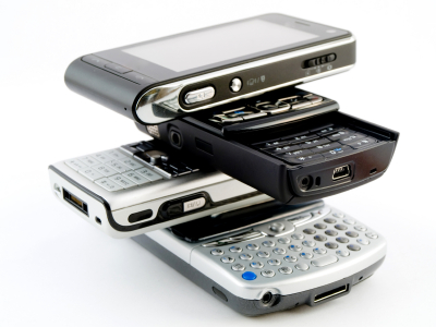 Stack Pile of Several Modern Mobile Phones PDA Cell Handheld Uni